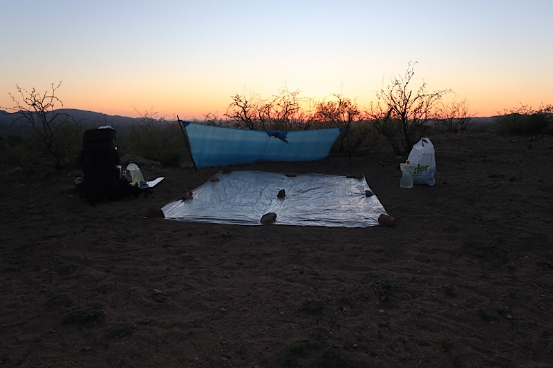 Camp with wind blocking tarp